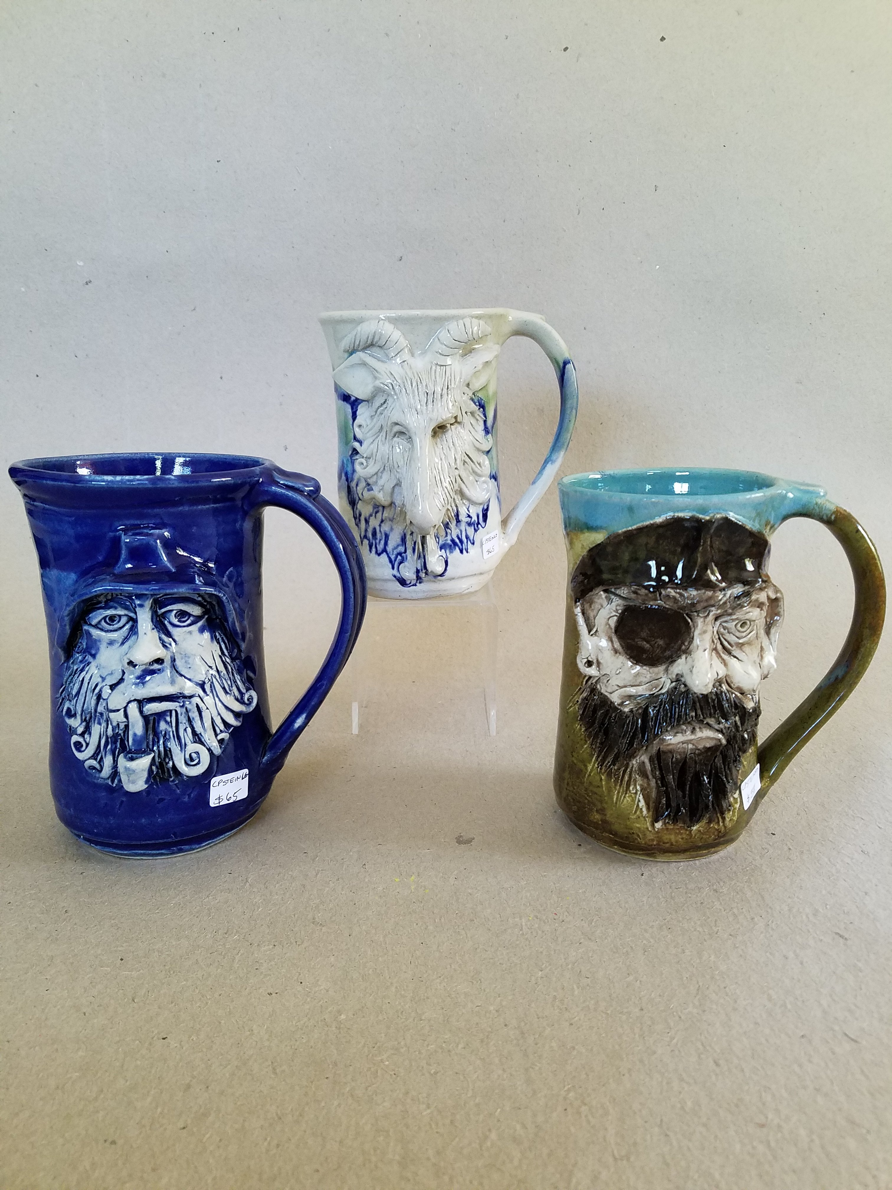 Camden Pottery face steins