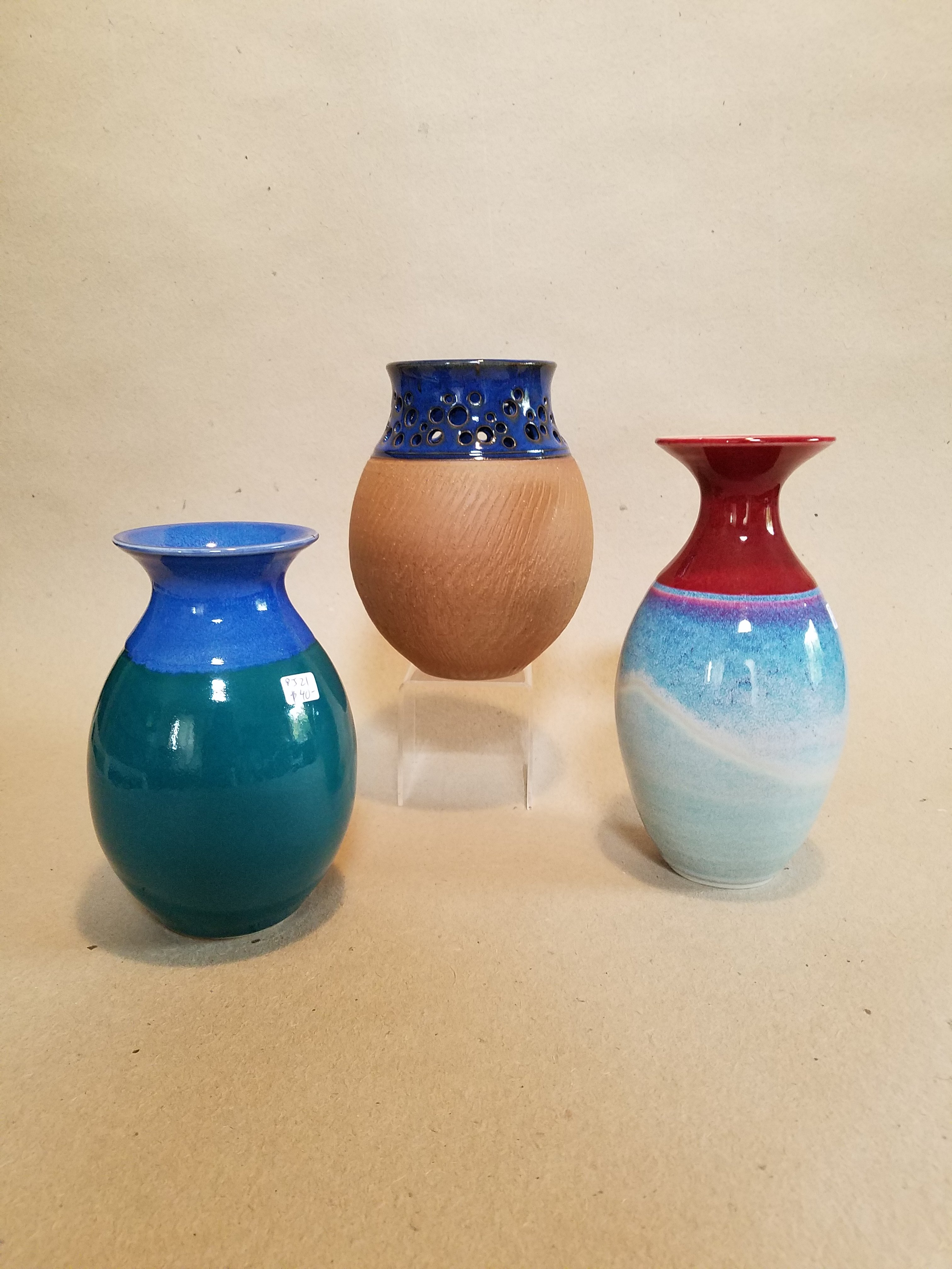 Peter Jones trio of vases