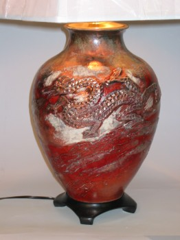 Raku fired lamp with dragon motif by Jamie Oates