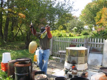 Putting raku fired pot into the can for post fire reduction